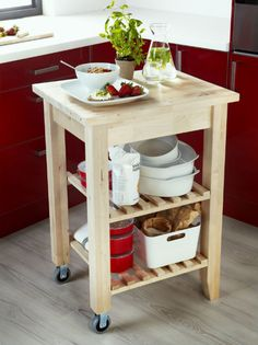 Is your kitchen too small for an island? A kitchen cart, like BEKVÄM, can be just as useful. Plus, the shelves give you even more portable storage space.