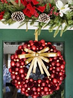 Cheery Red Wreath—Classic ornaments in a variety of sizes are used to create a festive and bright front door wreath. Gold ribbon provides the perfect contrast to the shiny red glass balls. Design by HGTV fan Laura Bruen. Outdoor Christmas Wreaths, Christmas Ornament Wreath, Christmas Door Decorations, Holiday Wreaths, Christmas Crafts, Christmas Tree, Christmas Ideas, Winter Wreaths, Christmas Balls