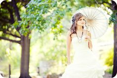 Beautiful bridal shot.  Love the bokeh and the parasol <3  In fact the whole shoot is pretty amazing!