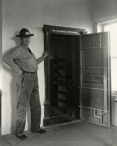 Vault of the Columbus State Bank, Columbus, New Mexico showing bullet hole from Pancho Villa's raid  Creator: New Mexico Tourism Bureau Date: 1938 Negative Number HP.2007.20.425 #columbus nm #bank vault #pancho villa #border war #new mexico #1916