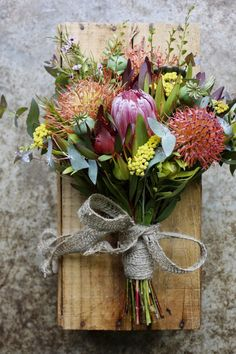Protea Wedding and Floral Bouquet. Inspiration for wedding flowers. Proteas are a great flower to include in your bridal bouquet and centerpieces. They make wonderful cut flowers. Summer wildflower bouquet for wedding 68 Protea Wedding, Summer Wedding Bouquets, Wedding Table Flowers, Wedding Flower Arrangements, Bridal Flowers, Floral Wedding, Floral Arrangements, Cut Flowers, Flower Table