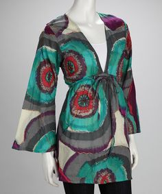 Absolutely eye-catching, this loose-fit tunic is dressed in a colorful psychedelic design. The adjustable waistline gives light to the feminine shape.Measurements (size S/M): 32'' chest (measured 1'' below arm); 32'' long from high point of shoulder to hem100% cotton voileHand washImp...