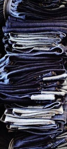 Pile of #denim blue #jeans.