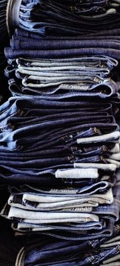 Pile of #denim blue #jeans.