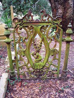 An ornate gate at the Bosque Bello Cemetery in Ferdinanda Beach on Amelia Island, Florida. Garden Gates And Fencing, Fence Gate, Door Gate, Old Gates, Wrought Iron Gates, Metal Gates, Porches, Fernandina Beach, Amelia Island