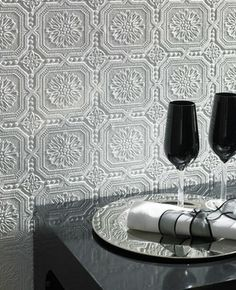 Textured paintable wallpaper?  Thinking of this to cover an old plaster kitchen ceiling.  Pain it metalic to simulate old tin tiles?