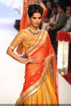 Former Miss India Manasvi Mamgai showcases a design by jewellery designer Gitanjali Gems during the India International Jewellery Week (IIJW), held at Grand Hyatt, Mumbai, on August 06, 2013.