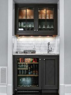 "During the renovation of a home in Greenwich, Conn., Anthony DeRosa of DeRosa Builders was able to incorporate a wet bar into the design of the family room without adding on or stealing space from the seating area. ""We fit the bar into a little-used closet,"" says DeRosa. #HomeBarDecor"