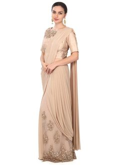 Saree gown featuring in net and lycra. Its enhanced in pearl and sequin embroidery along with pleated pallav. Matched with ready blouse in beige silk. Slight variation in color is possible. 95% of our customers believe that the product is as shown on the website.