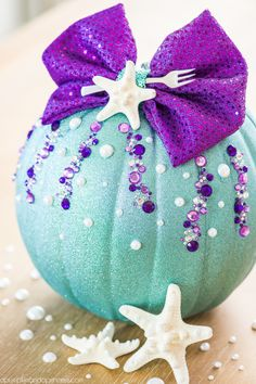 DIY No-Carve Little Mermaid Pumpkin – how to make a Disney Ariel inspired pumpkin with glitter, pearls, seashells and a mini fork to complete your under the sea creation. Disney Halloween, Holidays Halloween, Halloween Crafts, Elsa Halloween Costume, Pumpkin Decorating Contest, Pumpkin Contest, Mermaid Crafts, Mermaid Diy, Disney Christmas Decorations