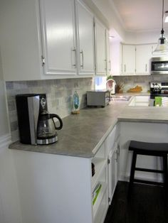 Make sure to check out Scott & Allie's kitchen renovation which includes affordable laminate Formica 180fx Soapstone Sequoia