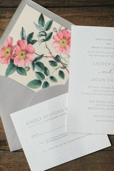 Floral lined envelopes. Swiss Cottage Designs. Photography: Kat Harris Photography - www.katharrisweddings.com