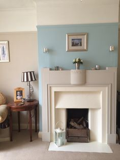 My lounge. Farrow and Ball 'Joas white' and 'Pointing', Laura Ashley 'Duck Egg' paints. Mantle painted in Autentico chalk paint 'Almond' and tiles in Farrow and Ball 'Talllow' eggshell. Cream Bedroom Walls, Blue And Cream Living Room, Duck Egg Blue Living Room, Duck Egg Blue Bedroom, Farrow And Ball Living Room, Dining Room Blue, Living Room White, Cream Walls, White Fireplace