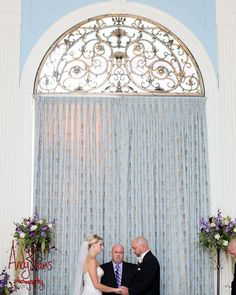 Photo showing off the windows. We won't have the ceremony inside but a photo making use of these windows as a background is a great idea.