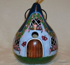 What a fun birdhouse made from a gourd!