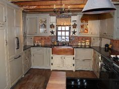 prim country kitchens | Before: The cabinets butt up against the window frame, reducing the ...