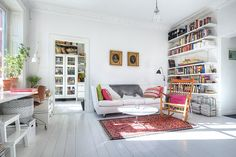 white walls white floors, wall to ceiling shelving