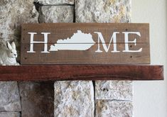 Rustic wooden sign handcrafted from reclaimed wood and hand-painted with the word HOME with a Kentucky silhouette. It looks great propped up on your