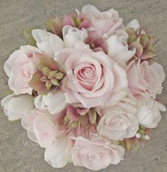 Gorgeous bridal bouquet made by Wedding and Events Floral Design with Sweet Avalanche by Meijer Roses!