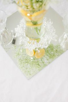 White yellow lemon summer wedding table centerpiece