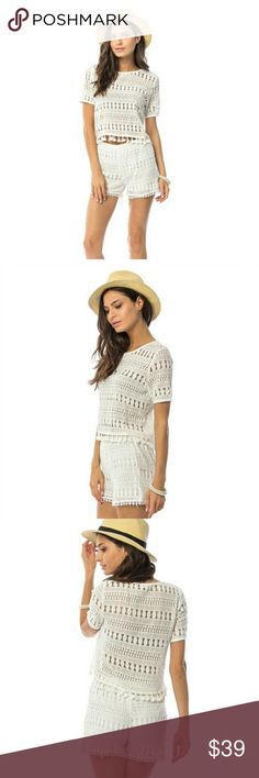 White crochet tassel two piece Summer vacation is calling you, and when you close your eyes and picture yourself with your toes in the sand, briskly walking the beach with the sound of crashing waves and a beautiful sunset background- it should be while wearing this adorable and trendy two piece white crochet set. Top features a tassel hem and bottoms include a lining.  70%Cotton 30%Polyamide Made in USA Other