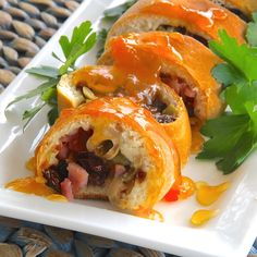 Venezuelan Swirled Ham Bread is filled with bacon, raisins, and olives and finished with a drizzle of apricot preserves.  #MyAllrecipes   #AllrecipesAllstars  #AllrecipesFaceless  #appetizer