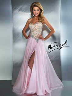 Amazing strapless floor length gown has a slight sweetheart and low cut back.  Prom dress features amazing embroidery on the fitted bodice and intircate embellishments on the waistline with a high leg slit.