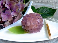 """How to make Wagashi """"Ajisai"""" or """"hydrangea"""" Candy:  This kind of elegant and refined sweet is called jōgashi or jōnamagashi. Jōgashi is a type of confection which is generally served during a Japanese tea ceremony, it is designed to reflect the changing seasons, mostly seasonal and natural motives like leaves and flowers are used. There are many different types of jōgashi, these can be prepared at home and served to guests as accompaniment to tea."""