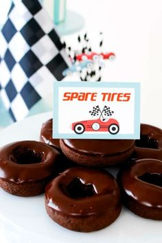 Don't miss this beautiful vintage car birthday party at CatchMyParty.com! The spare tire donuts are a cool idea! See more party ideas and share yours at CatchMyParty.com #catchmyparty #partyideas #vintagecars #cars #vintagecarparty #boybirthdayparty Car Birthday, Cars Birthday Parties, Disney Cars Party, Truck Cakes, Donut Party, Childrens Party, Donuts, First Birthdays, Food Ideas