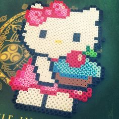 Hello Kitty with a cupcake perler beads by kawaiisammy
