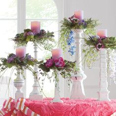 SHABBY CHIC: Décor - White Candle Sticks in various heights topped with Colored Candles in Floral Arrangements.