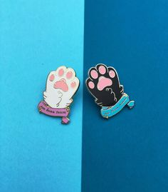 Are you a cat lover, or just a fan of all things adorable? Either way, this is the perfect piece of flair to add to your pin collection! Classy and cute, this silver plated hard enamel pin is just the piece you need to represent your favorite furry friends. Join the toe bean team!  Pairs purrfectly with the white paw version!  Materials: Hard enamel, gold plating Dimensions: ~1.25 in height  Illustration: Digitally rendered image re-worked to fit purrfectly on a pin, ready to add to your…