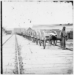 City Point, Virginia. Negro soldier guarding 12-pdr. Napoleon Cannons (Model 1857?) - 1865
