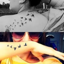 Image result for dois passaros voando tattoo