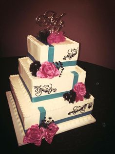 Bold colors such as pink and teal to add a fresh look to a simple wedding cake.