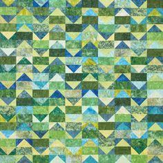 Sew Flying Geese blocks to make a soothing quilt using an assortment of blue and green batiks. Fabrics are Ceylon, Key Lime, and Chamomile fat-quarter bundles from Hoffman California Fabrics.