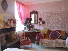 White wood floors, lace-covered couch, pink curtain....bedroom wishes