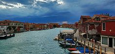 Murano: town of the Venetian lagoon, north-east of Venice, known for its glass art work.