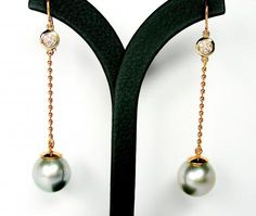 2 beautiful 15-16 mm Tahitian blue/grey pearls and 14 K white/gold/rose gold with .14 Ct Top Diamonds - www.amsterdampearls.com