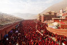Monks gather in front of a temple during a festival at Larung Gar, Seda Buddhist Institute.