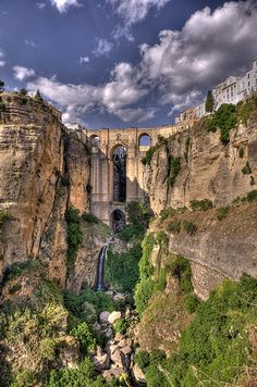 view of Old Town on Cliff Puente Nuevo (New Bridge), Ronda Malaga Spain.Spans deep canyon carved by Guadalevin River. built The tallest bridge above the canyon floor Places Around The World, Oh The Places You'll Go, Places To Travel, Places To Visit, Around The Worlds, Alicante, Wonderful Places, Beautiful Places, Voyage Europe