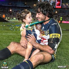 JT with daughter Frankie after the NRL grand final