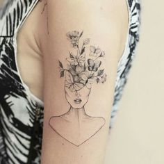 Butterfly flower head juxtaposition tattoo