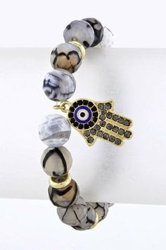 Black and White Marble Hamsa Bracelet with Hamsa Charm and Evil Eye - Faux Agate Stone Bracelet with Gold Hamsa and Evil Eye Charm StarShine Jewelry. $14.99. The Khamsa / Hamsa (Arabic), Hand of Fatima (Islamic), and Hand of Miriam (Jewish) is a polular symbol believed to protect against evil eye. It has long represented blessings, power, strength, the hand of God, divine power, providence and generosity.. Stretchy: One size fits most teens adults. Bead diameter :4mm. Acce...