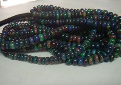 Hey, I found this really awesome Etsy listing at http://www.etsy.com/listing/157606451/ethiopian-black-opal-beads-15-pcs-total