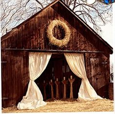 A barn becomes a chapel. Beautiful.    We are using a barn also, this is a great doorway presentation, although I expect that amount of fabric might be cost prohibitive, rather give it to the bar!