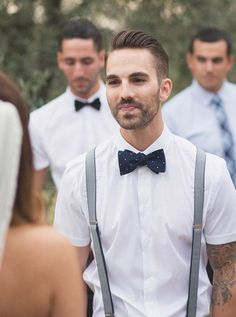 a cotton white shirt with short sleeves, a navy bow tie and suspenders to go