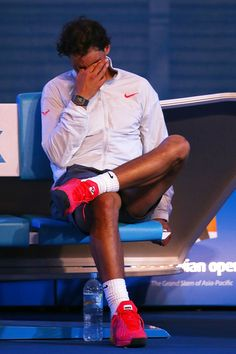 Rafael Nadal of Spain wipes his face after losing the men's final match against Stanislas Wawrinka of Switzerland during day 14 of the 2014 ...