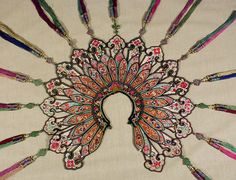 "Wedding Collar or Cape Yunnan, China. 19th century Silk embroidery on silk; tassels and metal ornaments. 51""x 48."""