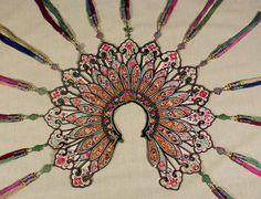 Wedding Collar or Cape  Yunnan, China. 19th century.  Silk embroidery on silk; tassels and metal ornaments.   http://www.marlamallett.com/e-6678.htm
